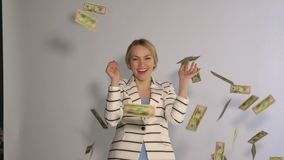 Successful business woman under the money rain. The concept of financial success. Slow motion stock footage