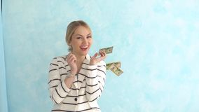 Successful business woman under the money rain. The concept of financial success. Slow motion stock video footage