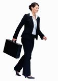 Successful business woman walking with a briefcase Royalty Free Stock Image