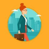 Successful business woman walking with briefcase. Royalty Free Stock Images