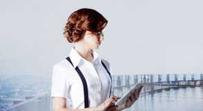 Successful business woman working on laptop, city Royalty Free Stock Image