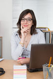 Successful business woman working at the office looking at camera Royalty Free Stock Image