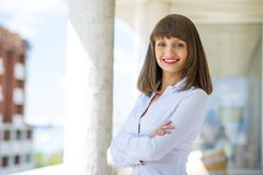 Successful business woman. Young successful business woman smiling and looking in camera Royalty Free Stock Image