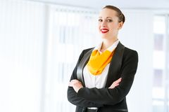 Successful business woman. Young successful business woman smiling and looking in camera Stock Photos