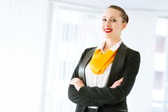 Successful business woman. Young successful business woman is standing with his arms crossed Stock Image