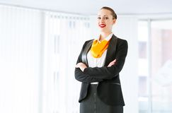 Successful business woman. Young successful business woman is standing with his arms crossed Stock Photos