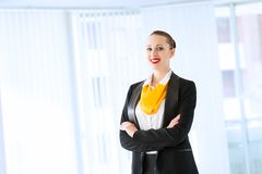 Successful business woman. Young successful business woman is standing with his arms crossed Royalty Free Stock Photos
