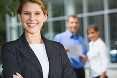 Successful business women. Successful young woman in a business environment royalty free stock photos