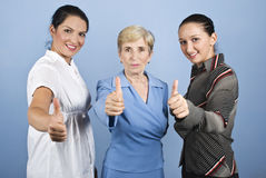 Successful  business women giving thumbs up. Three business woman,young and senior giving thumbs up and smiling isolated on blue background,check also Business Stock Photo