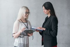 Successful business women guidance instruction. Successful business women. Guidance and instruction. Confident female CEO discussing new tasks with employee royalty free stock photo