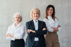 Successful business women professional career. Successful business women. Professional career. Confident mature and young ladies standing with arms folded stock photo