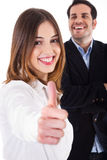 Successful business women showing thumbsup Stock Photos