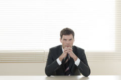 Successful businessman. Portrait of a successful businessman at his desk Royalty Free Stock Photo