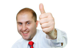 The successful businessman. Shows a thumb that at it all perfectly Royalty Free Stock Image