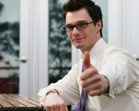 Successful businessman. Happy businessman gives the thumbs up gesture Royalty Free Stock Image