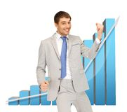 Successful businessman with 3d chart Royalty Free Stock Photos