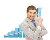 Successful businessman with 3d chart Royalty Free Stock Photo