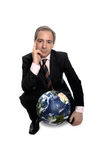 Successful businessman. Successful business man behind a world globe, over a white background - Business Power concept royalty free stock photos