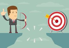 Successful businessman aiming target. With bow and arrow Royalty Free Stock Photos