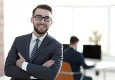 Successful businessman on background of office. Photo with copy space royalty free stock images