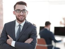Successful businessman on background of office. Photo with copy space royalty free stock photos