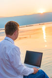 Successful businessman on the beach Stock Image