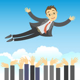 Successful businessman being thrown in the air by his teamwork Royalty Free Stock Photo