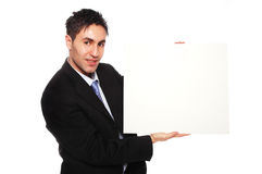 Successful businessman and blank cardboard Stock Photos
