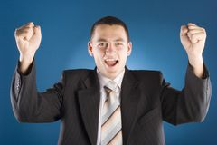 Successful businessman with both hands up Royalty Free Stock Image