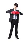 Successful businessman with boxing gloves Stock Photo