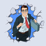 Successful Businessman Breaking the Wall Stock Photo