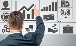 Successful businessman with business icons Stock Images