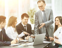 Successful businessman and business team at a seminar in modern office Stock Image