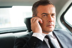 Successful businessman in car. Stock Photography