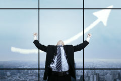 Successful businessman celebrating his achievement Royalty Free Stock Photography