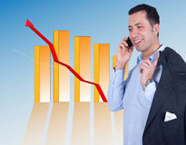 Successful Businessman with a chart behind Royalty Free Stock Photos