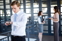 Successful businessman checking time Stock Images