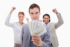 Successful businessman with cheering colleagues Stock Images
