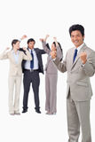 Successful businessman with cheering team Stock Photography
