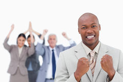 Successful businessman with cheering team behind him Stock Photo