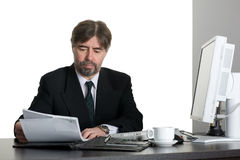 Successful businessman with computer Stock Images