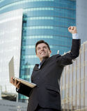 Successful businessman with computer laptop happy doing victory sign Stock Photos