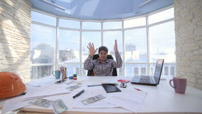 Successful businessman counting and throwing up US dollar money in bright clean office. Business, money, success concept stock video
