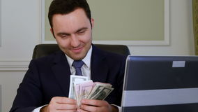 Successful businessman counts looking satisfied. Close up. Professional shot in 4K resolution. 055. You can use it e.g. in your commercial video, business stock video footage
