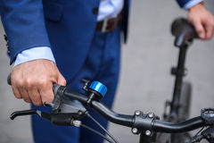 Successful businessman cycling on road Stock Image