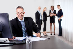 Successful businessman doing some paperwork Stock Images