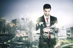 Successful businessman with double exposure stock image