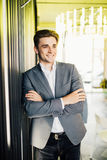 Successful businessman dressed in expensive suit is standing in hallway his company. Young male manager is posing in modern office. Successful businessman stock photos