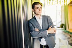Successful businessman dressed in expensive suit is standing in hallway his company. Young male manager is posing in modern office. Successful businessman royalty free stock images