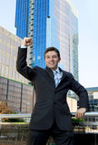 Successful businessman excited and happy doing arm winner sign Royalty Free Stock Photo